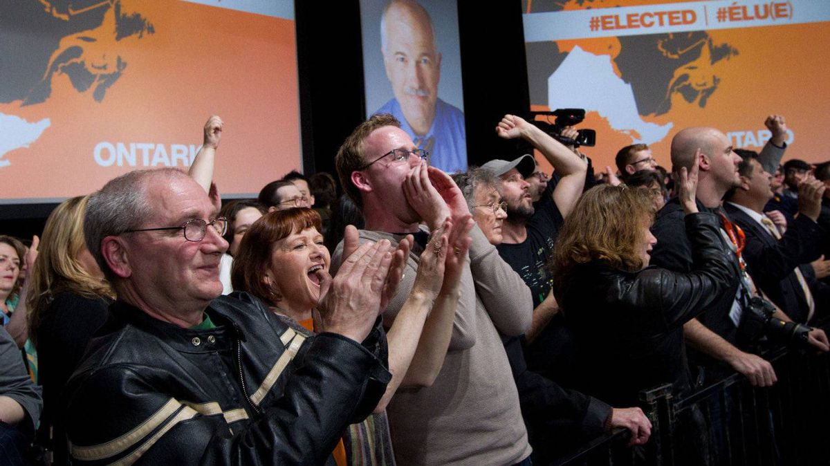 New Democratic Party supporters cheer as they watch results at NDP leader Jack Layton's election event in Toronto, Ont., on Monday, May 2, 2011.