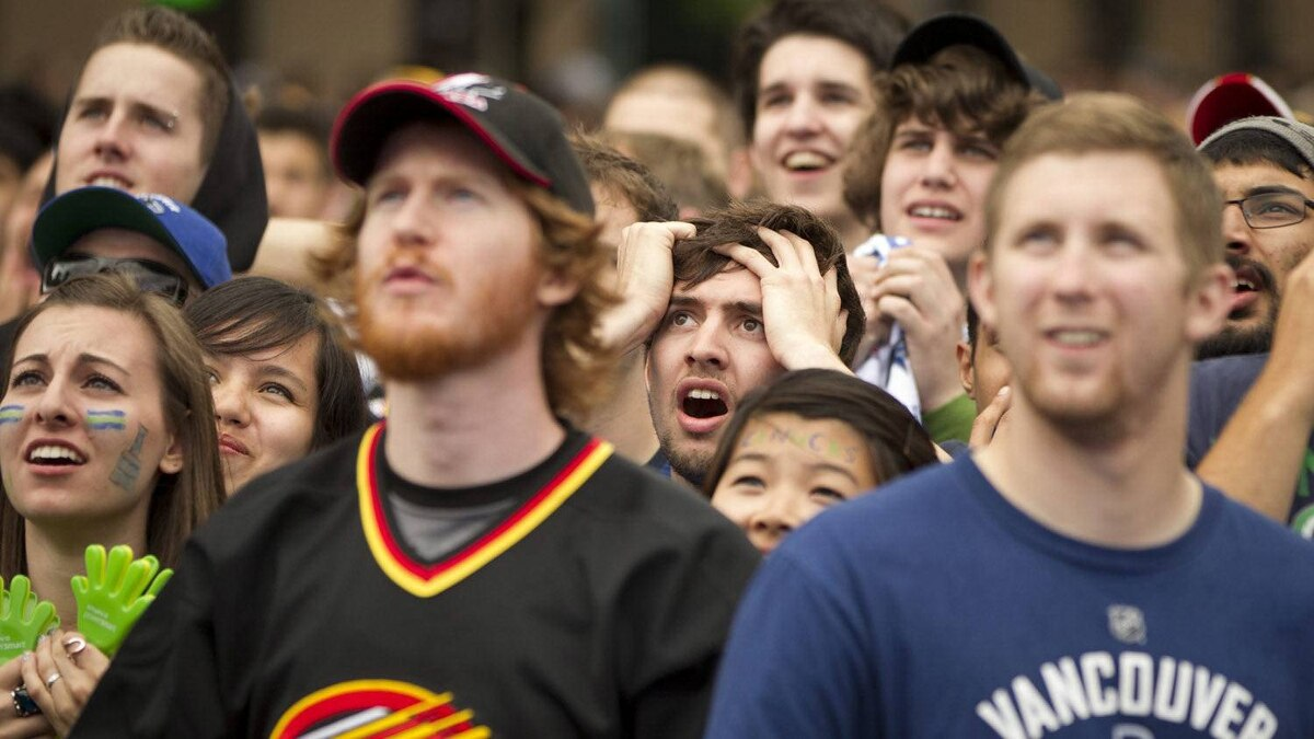 Dejected Canuck fans in Vancouver watch Game 6 of the Stanley Cup final televised from Boston June 13, 2011.