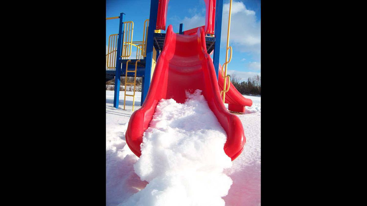 Snowy day picture of a playground slide in Bobcaygeon, Ontario Picture taken Sunday, Jan. 22, 2012