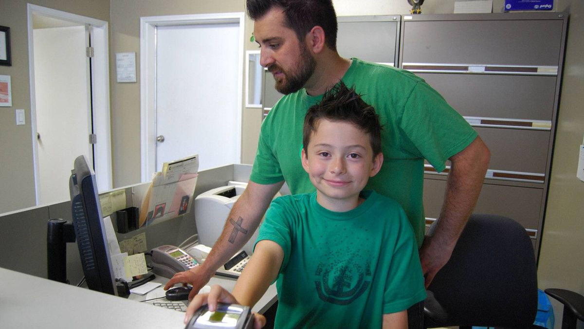 Joel Luyt, owner of Outpost Imports in Abbotsford, B.C., puts his son, Isaac, to work at the company's warehouse.