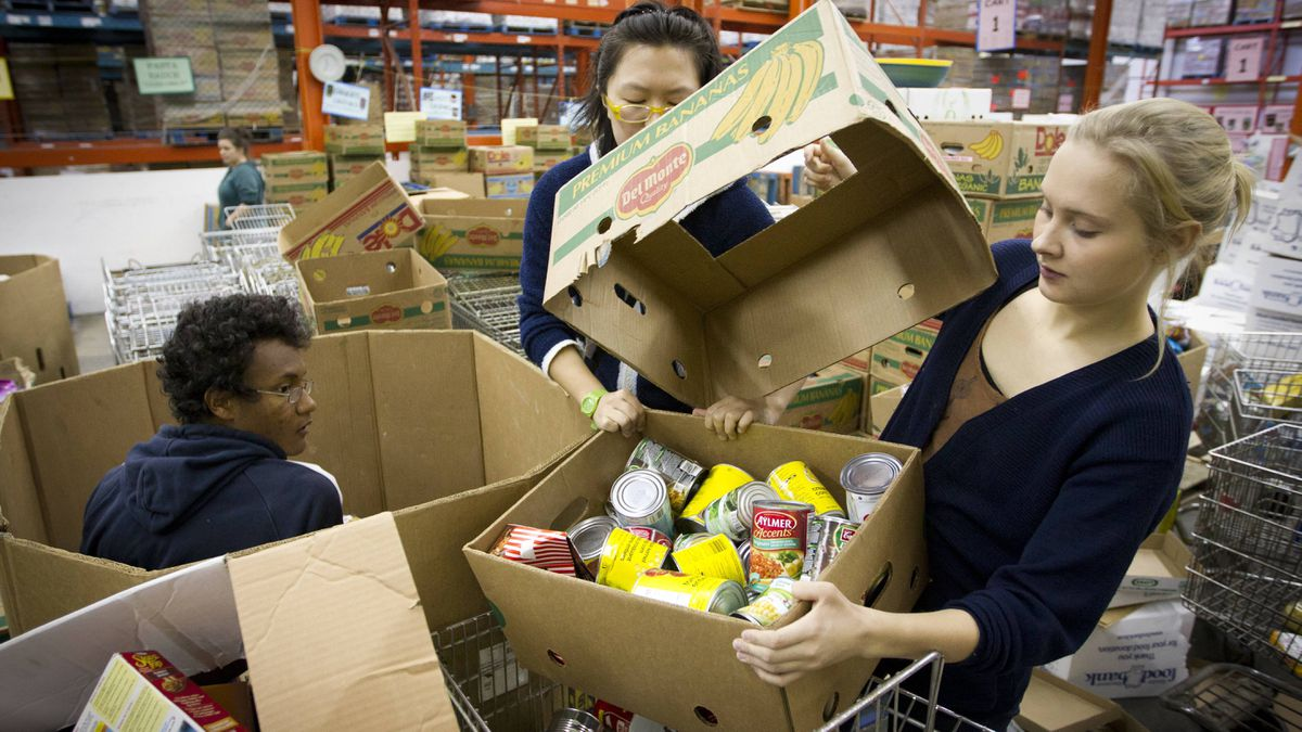 Volunteers at the Great Vancouver Food Bank sort incoming donations at a warehouse on Oct. 25.