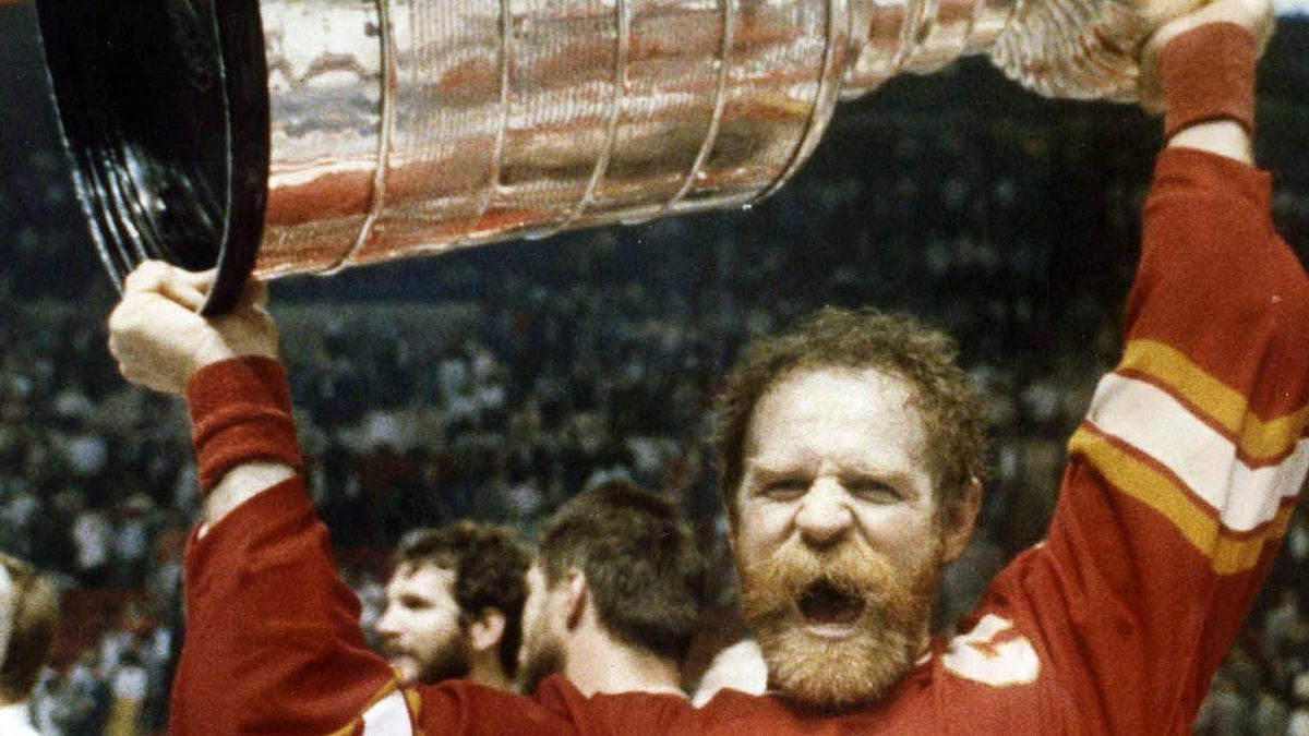 Calgary Flames' Lanny McDonald raises the Stanley Cup in Montreal Thursday, May 25, 1989 after Flames defeated Canadians. May used to be the month when NHL playoff hockey grabbed the attention of Canadians. The lockout ruined that experience this year, but vivid memories remain from Stanley Cup play in the 1970s, 1980s and 1990s. (CP PICTURE ARCHIVE - Bill Grimshaw)