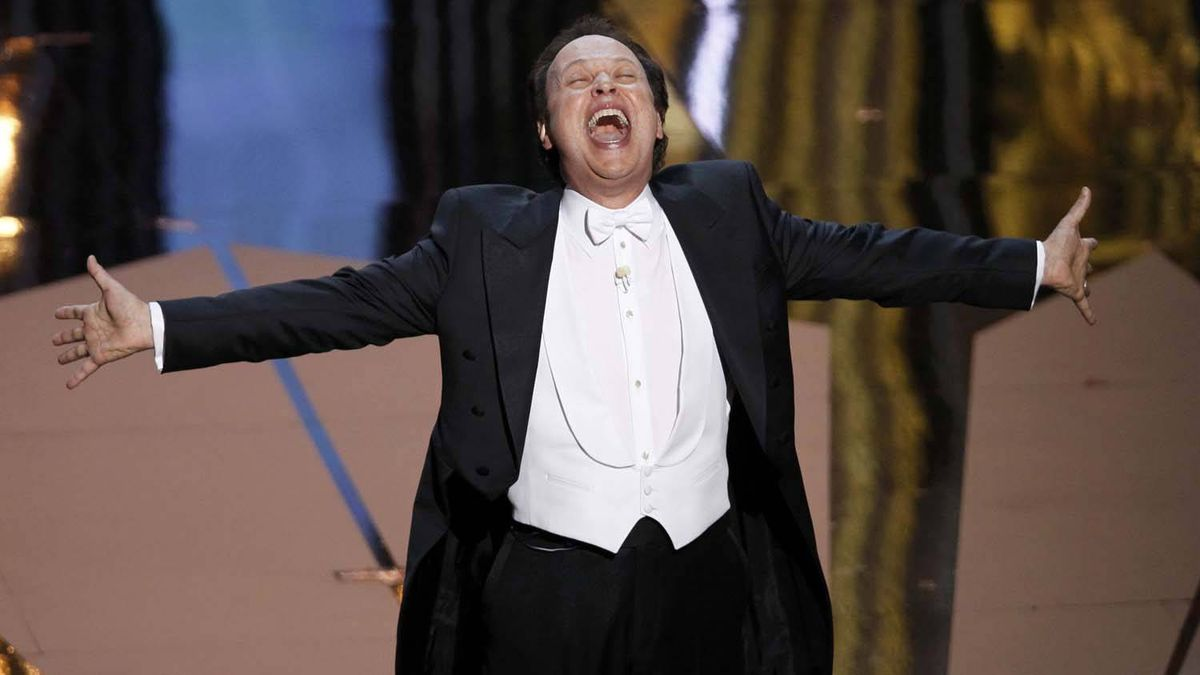 Oscar host Billy Crystal sings at the beginning of the 84th Academy Awards.