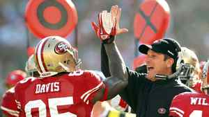 San Francisco 49ers tight end Vernon Davis (L) is congratulated by head coach Jim Harbaugh after his first quarter touchdown catch during their NFL NFC Divisional playoff football game in San Francisco, California January 14, 2012.