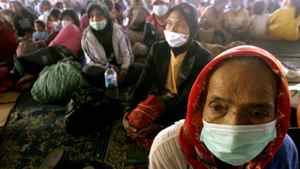 Villagers wearing face masks, who were evacuated from the area around the erupting Mount Sinabung volcano, wait at a shelter in Brastagi outside the city of Medan, North Sumatra August 29, 2010.