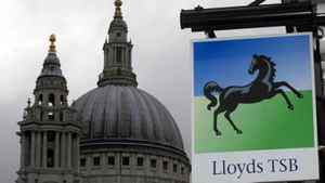 A Lloyds bank branch sign is seen near St Paul's Cathedral in London.