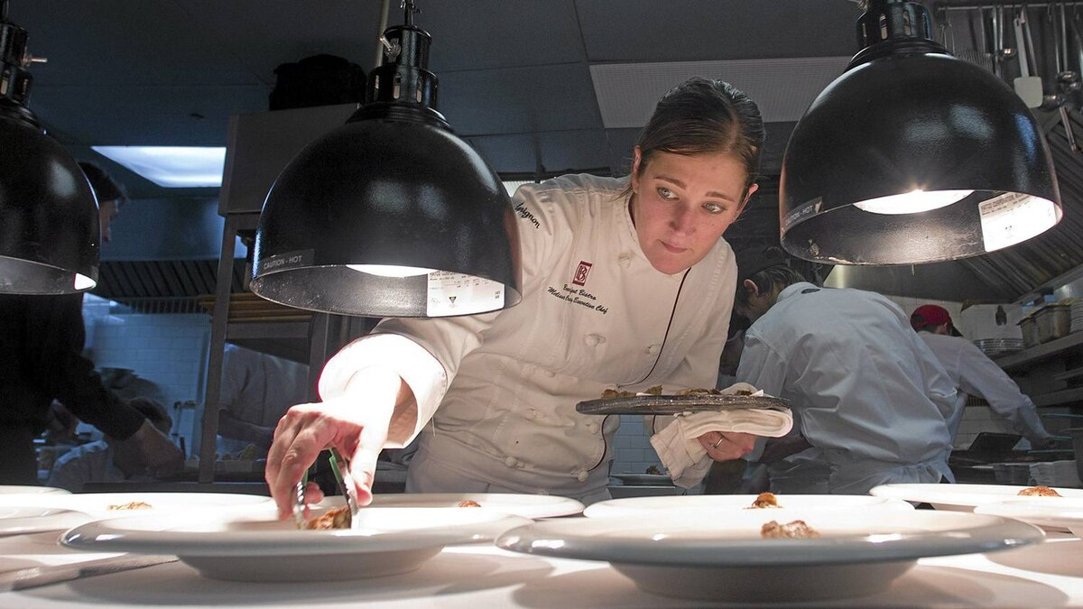 Chef Melissa Graig serves up food as she guests at Chez L'Epicier during the High Lights festival in Montreal, February 17, 2011.