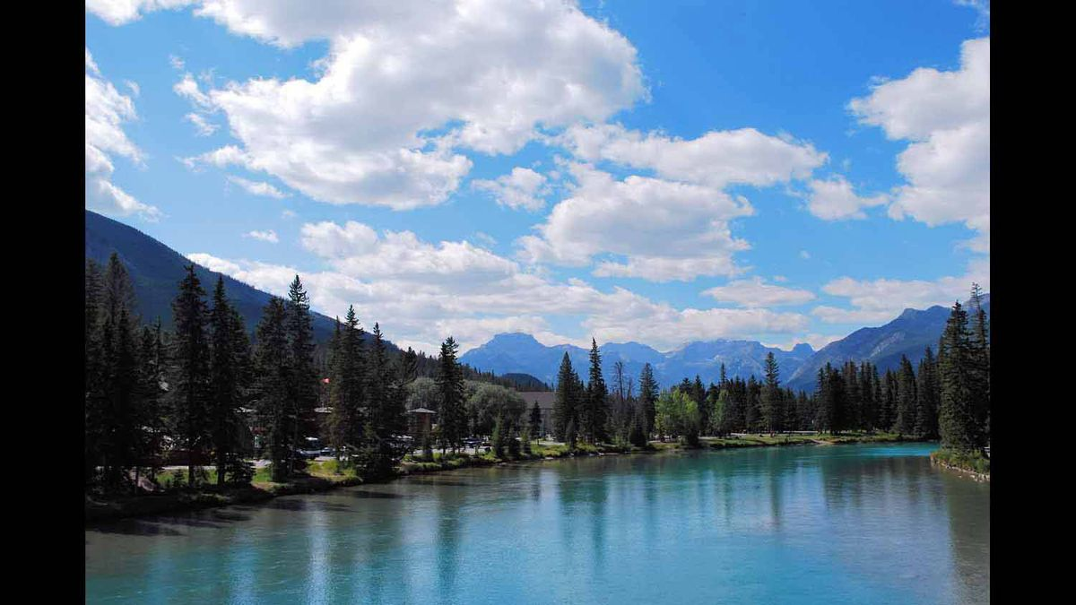 The smooth sheet of crystal blue water creates a serene atmosphere in Banff, Alberta last summer.