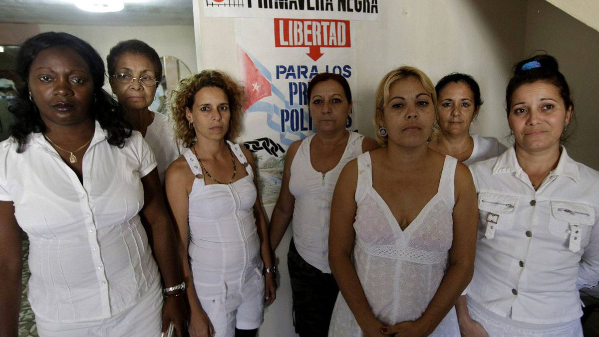 Leader of the dissident group Ladies in White, Berta Soler, left, poses with members of the group at the home of deceased leader Laura Pollan, in Havana March 19, 2012.