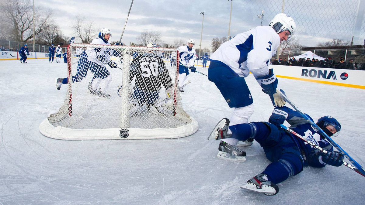 Leafs captain Dion Phaneuf takes down Darryl Boyce behind the net as the Toronto Maple Leafs held an outdoor practice at Sunnydale Acres Rink in Toronto.