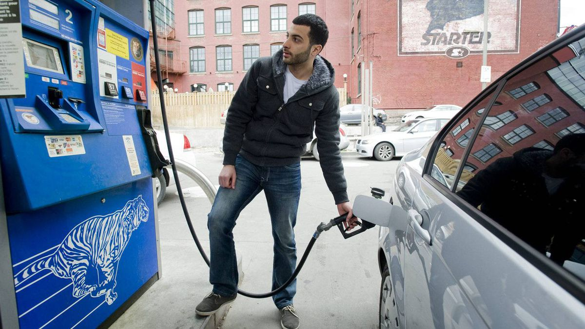 Mostafa Mahmood puts gas in his car Wednesday in Montreal. Prices rose across Canada, and analysts are pointing to speculation as the cause.