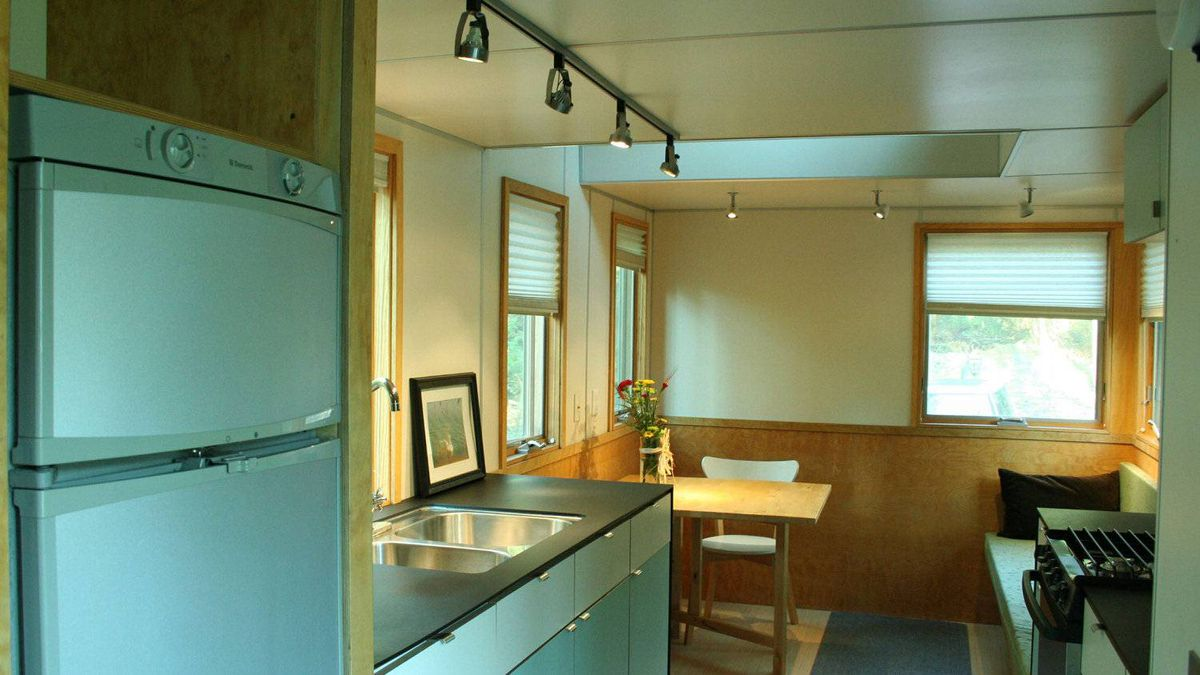 The kitchen and eating area. The house is now being rented out at the Timber House Country Inn Resort in Brighton, Ont.