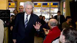 Bloc Quebecois Leader Gilles Duceppe waves to a supporter during a visit to a restaurant in Montreal onTuesday March 29.