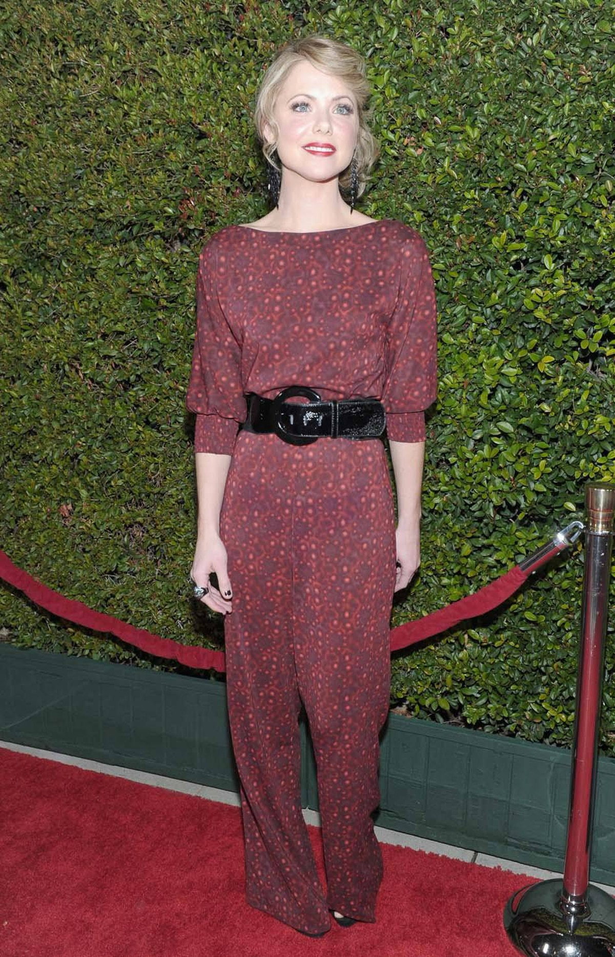 "Actress Collette Wolfe went the other way at the ""Young Adult"" premiere in Beverly Hills last week and wore all of one motel curtain."