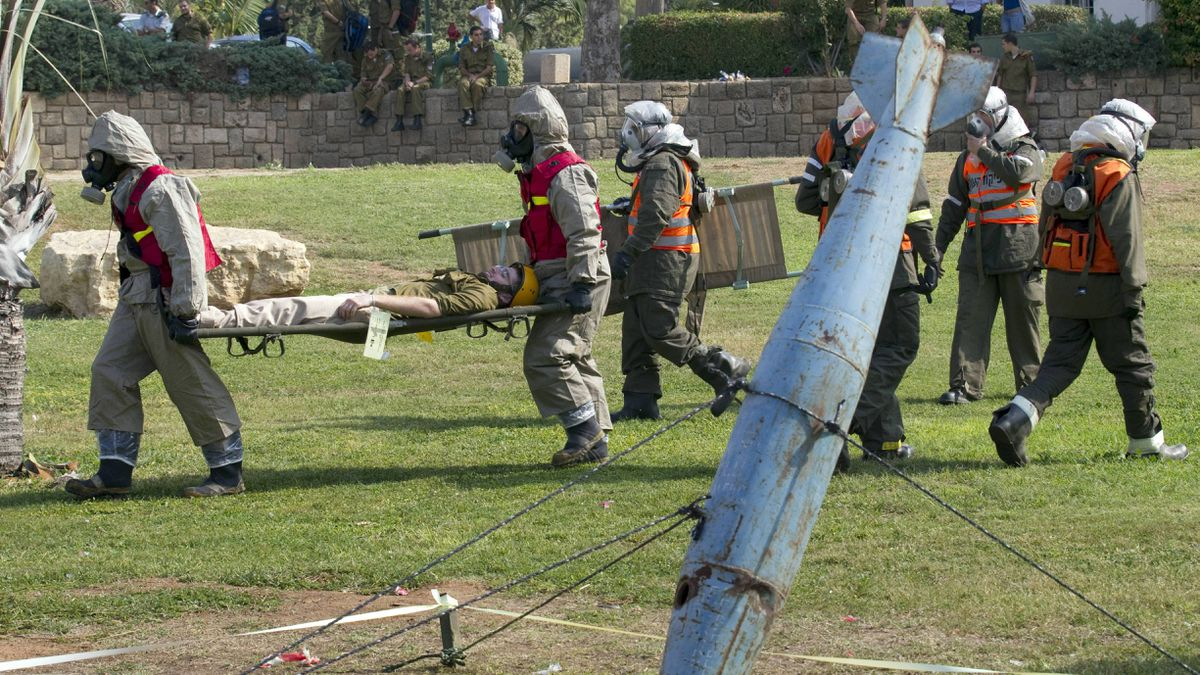 Israeli soldiers from the army's Home Front Command and rescue teams take part in defence drill simulating a missile attack at a school in Holon, near Tel Aviv, on Thursday.