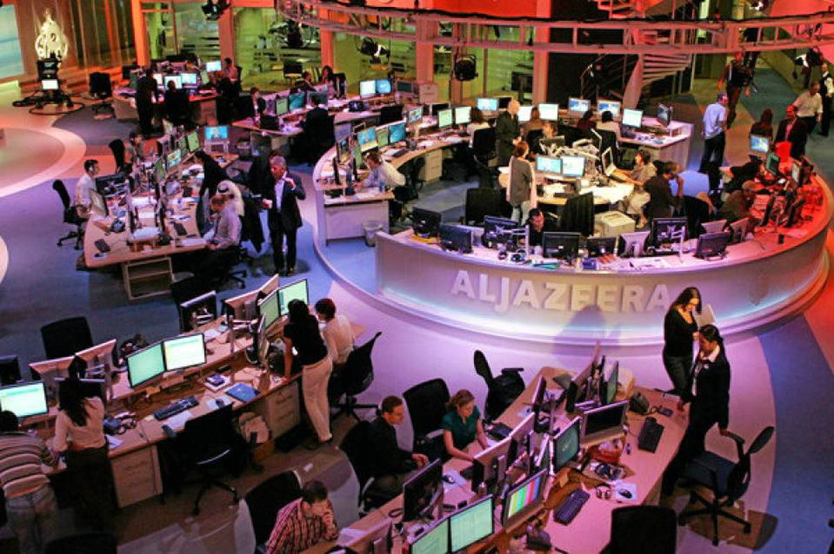 Staff work at the English-language newsroom at the headquarters of the Qatar-based Al Jazeera satellite channel in Doha.