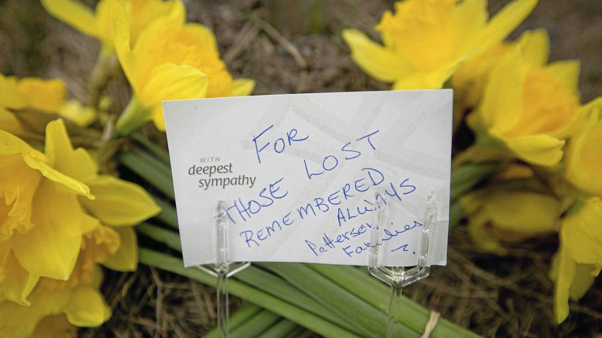 Flowers lie outside Lakeland Sawmill in Prince George, B.C., April 25, 2012 to remember the two people who died after a fire and explosion at the mill.