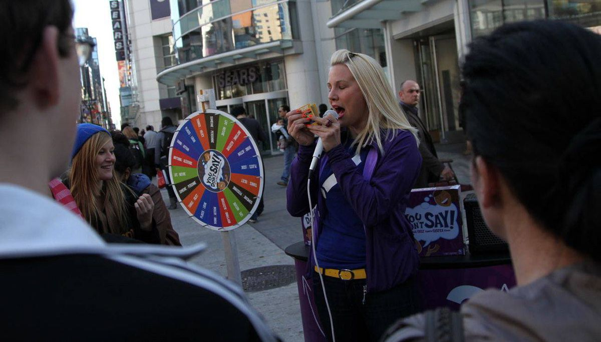 Elise Goodhoofd promotes the new board game of Spin Masters, You Don't Say, that consists on cards with trivia questions that need to be answered by the participants, in downtown Toronto October 27, 2010. (Fernando Morales/The Globe and Mail)