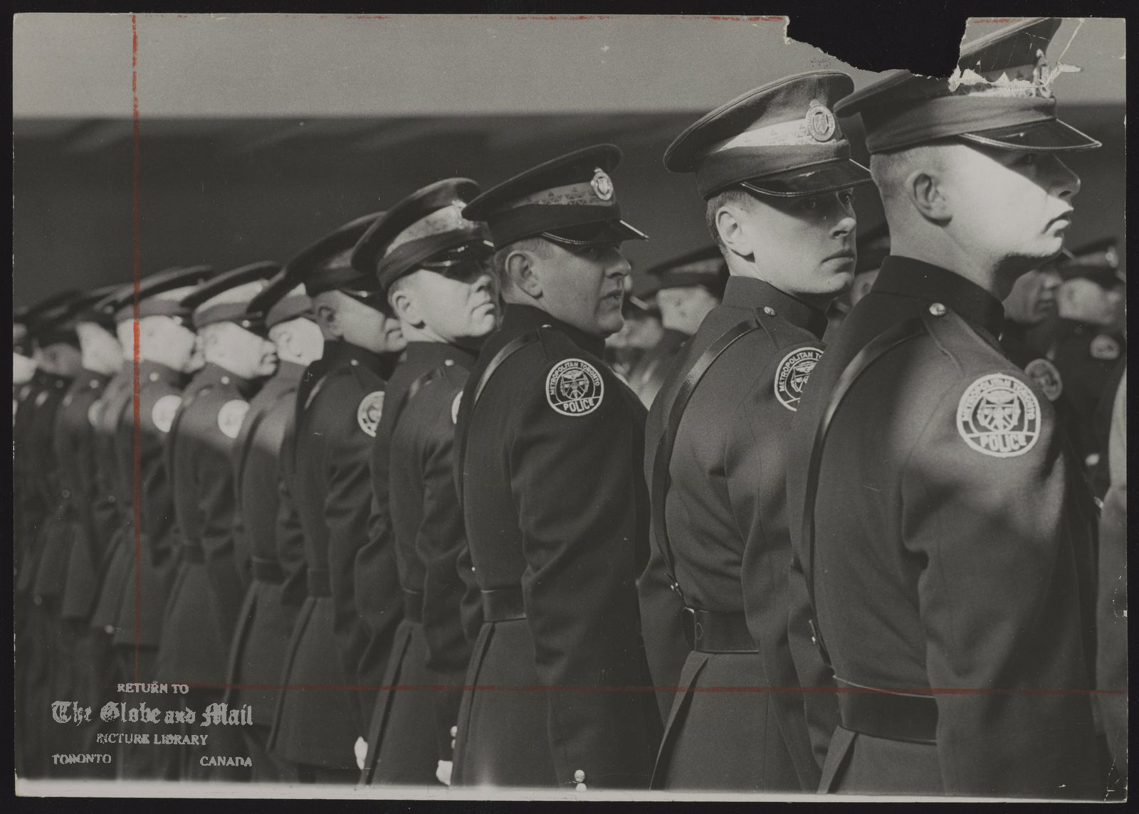 TORONTO metro Police Dept. All eyes are to the right as 83 policemen form up for graduation parade at Metropolitan Toronto Police College at Denison Armories.