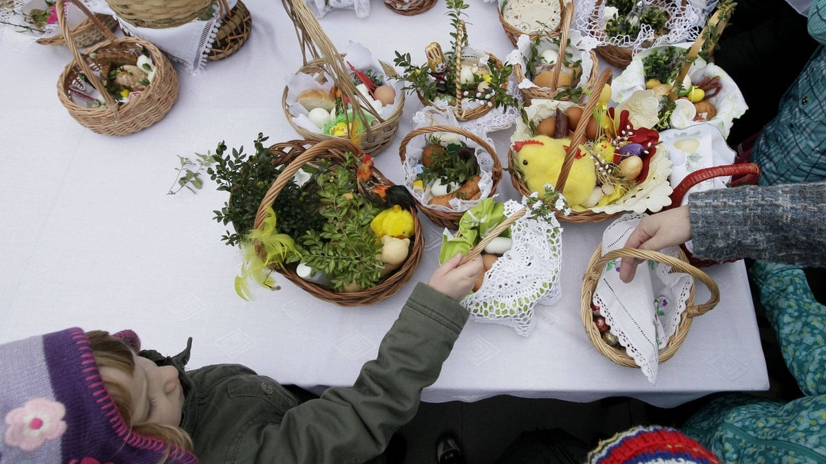 Children wait with their baskets for food samples at the St. Kostka church in Warsaw on Saturday. Poles bring baskets that traditionally contain an egg, bread, salt, pepper, sausage, horseradish and butter to churches to be blessed on Holy Saturday.