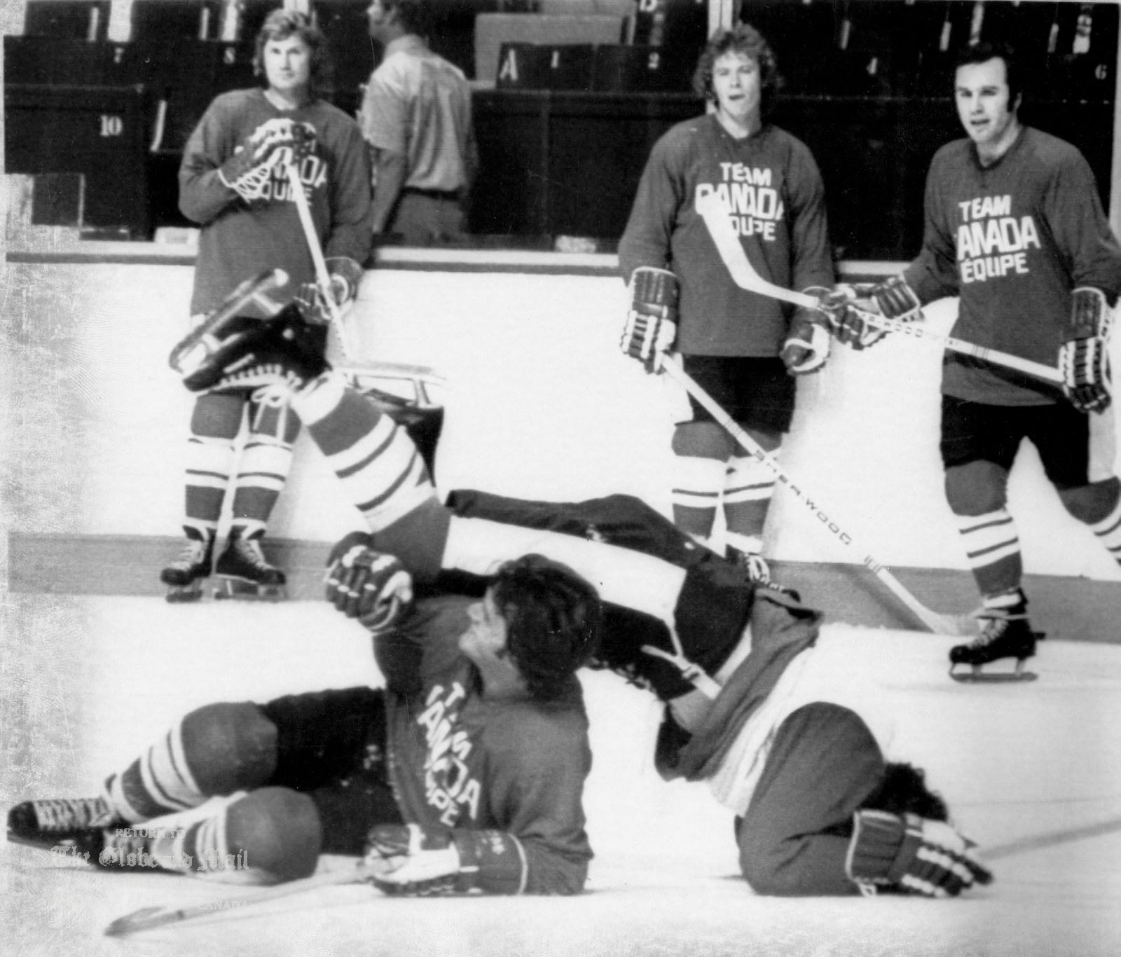 SEPTEMBER 1, 1972 -- MONTREAL -- TEAM CANADA PRACTICE -- Brian Glennie of the Toronto Maple Leafs topples over Marcel Dionne of the Detroit Red Wings at the Montreal Forum, Friday, Sept. 1, 1972. The two escaped injury while other members of Team Canada look on. Members of Team Canada are practicing for Saturday night's game which is the first of the Canada-Russia summit series. CP PHOTO