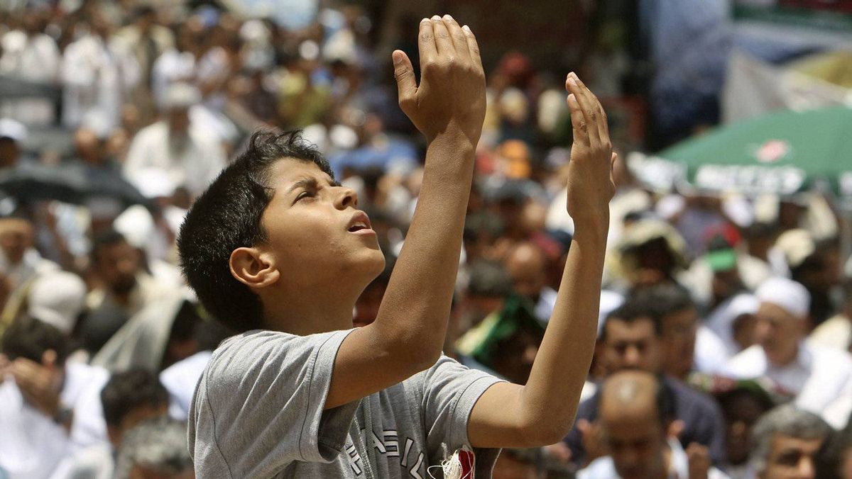 A Libyan boy attends Friday prayers in Benghazi on June 10, 2011.