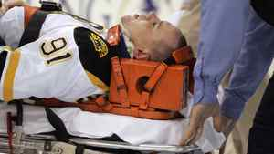 Marc Savard #91 of the Boston Bruins is taken off the ice by medical staff after being injured in the third period against the Pittsburgh Penguins at Mellon Arena on March 7, 2010 in Pittsburgh, Pennsylvania. The Penguins defeated the Bruins 2-1. (Photo by Justin K. Aller/Getty Images)