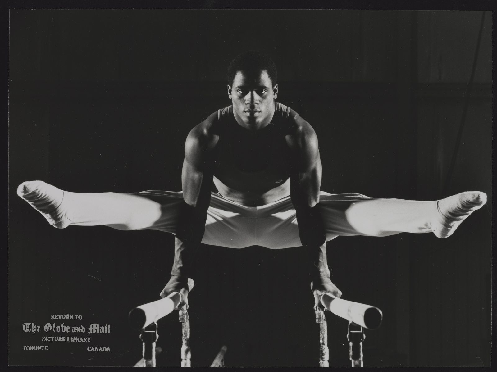 The notes transcribed from the back of this photograph are as follows: Curtis HIBBERT Toronto. Gymnast