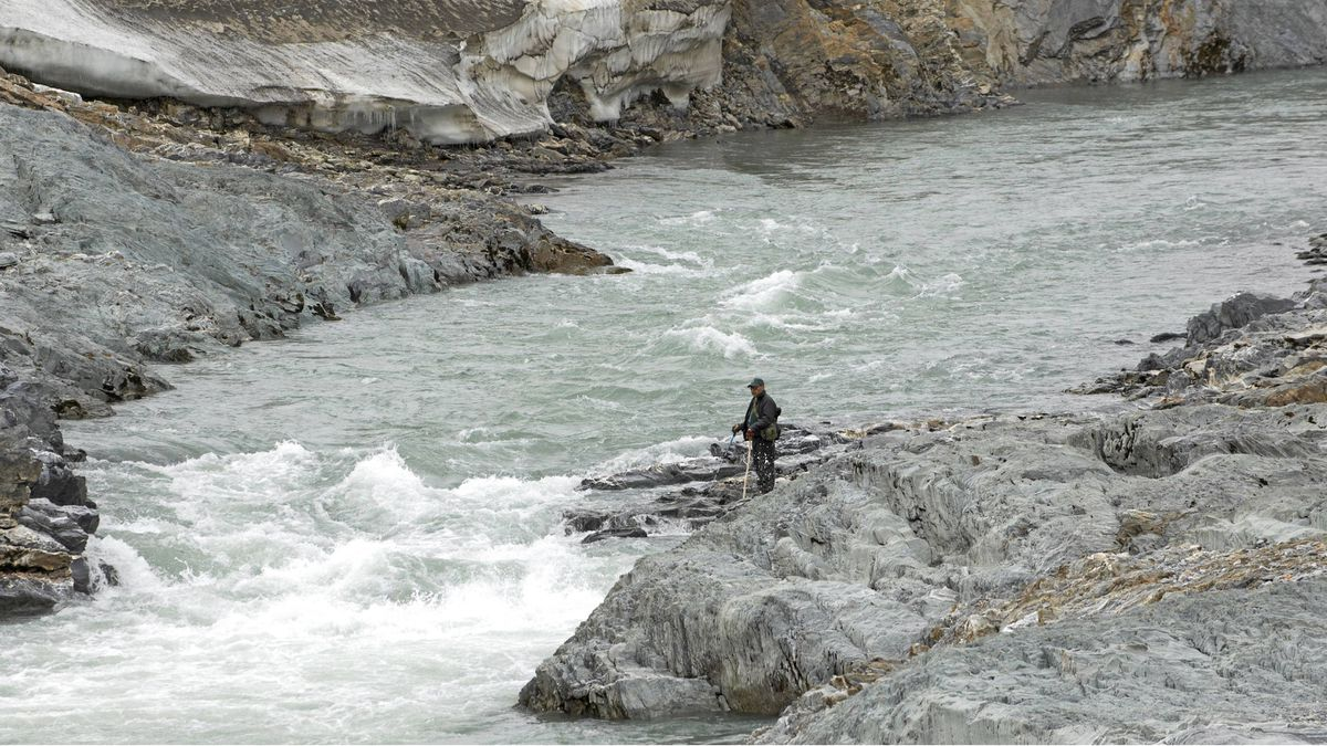 Freed of its icy cloak, the Firth River swells to a thick turquoise torrent that pounds through deep, rocky canyons. Here, Parks Canada officer Mervin Joe monitors the Firth River for wildlife and rafters.