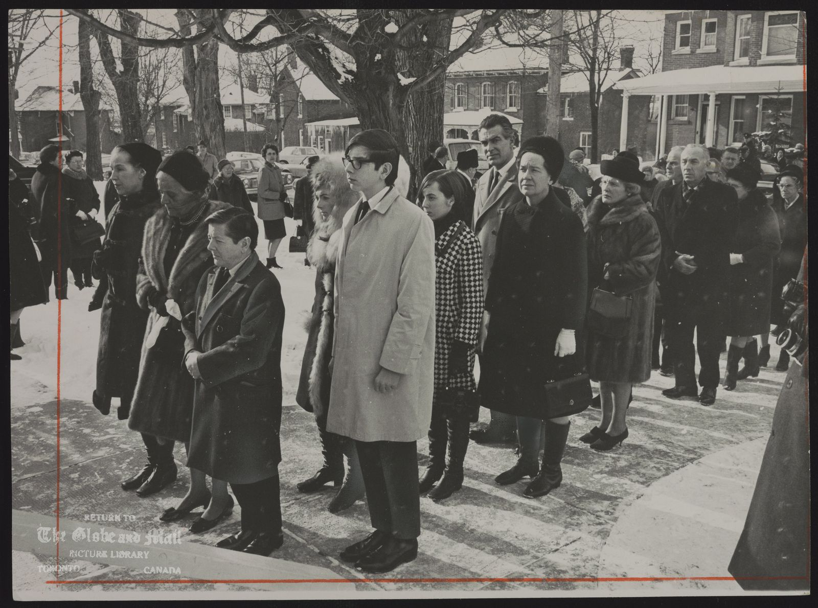 Vincent MASSEY Leading the file at Massey funeral are Mr. and Mrs. Hart Massey, flanking Mrs. Leigh Goosage. Behind Mr. Massey are his son Jonathan and the daughters of Mr. Lionel Massey. Rev. G.E. Moffat conduct the service. The former Governor-General died December 30, 1967.
