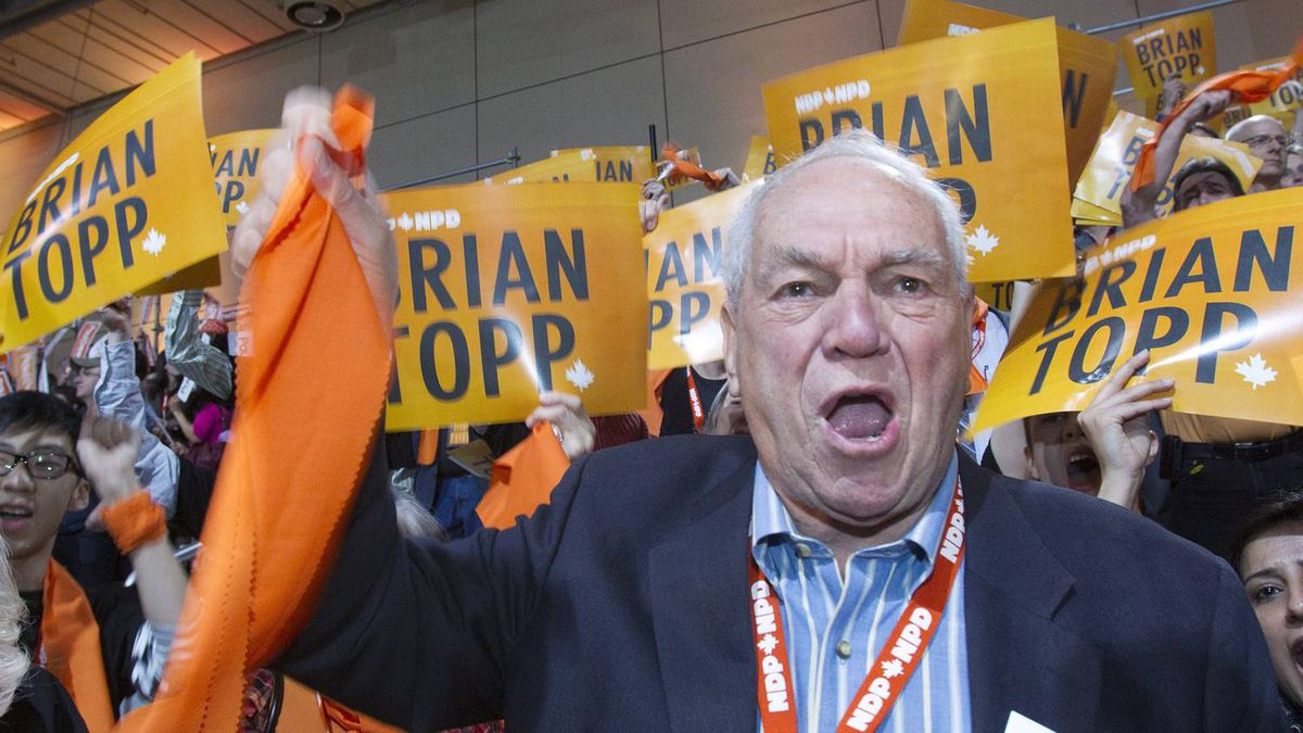 Former NDP leader Ed Broadbent reacts with Brian Topp supporters during the NDP leadership convention in Toronto on Saturday, March 24, 2012.