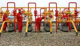 Workers check the pipelines at a PetroChina oil field on the outskirts of Guang'an, Sichuan province.