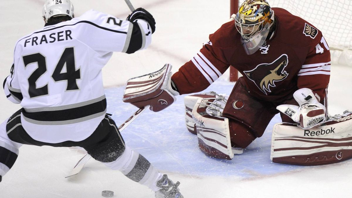 Phoenix Coyotes goalie Mike Smith (41) makes a stick save on Los Angeles Kings center Colin Fraser (24) in the 1st period during Game 5 of the NHL Western Conference hockey finals in Glendale, Arizona, May 22, 2012. REUTERS/Todd Korol