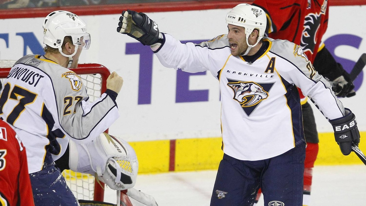 Nashville Predators forward Patric Hornqvist, left, celebrates his goal with teammate forward Steve Sullivan during the third period of their NHL hockey game against the Calgary Flames.