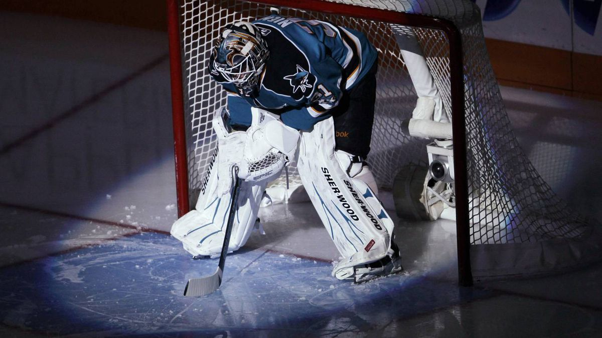 San Jose Sharks goalie Antti Niemi is lit by a spotlight before the Sharks' NHL hockey game against the Phoenix Coyotes in San Jose, Calif., Saturday, April 9, 2011, as he was named the Sharks' player of the year. The Sharks won 3-1. (AP Photo/Paul Sakuma)