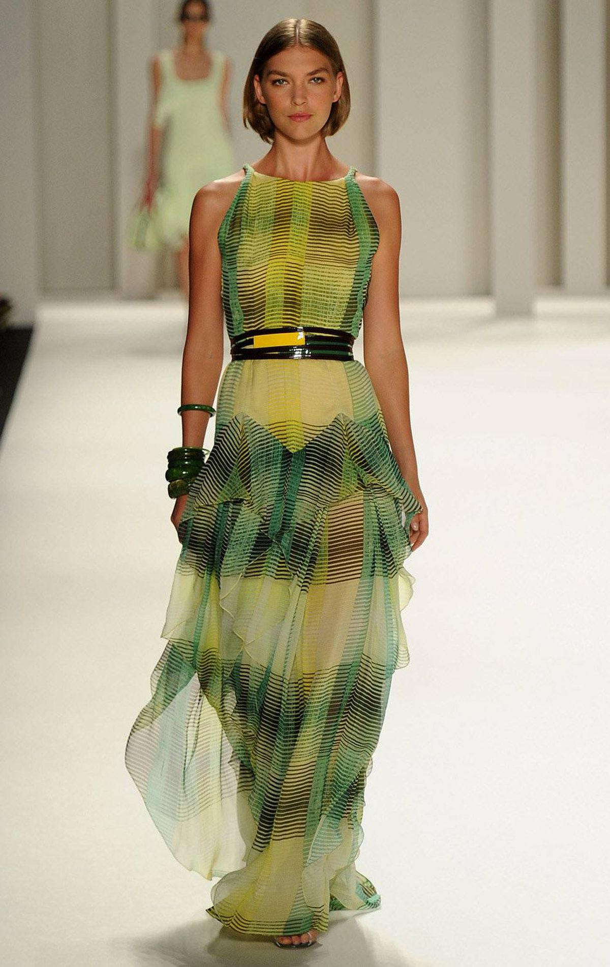 A model walks the runway at the Carolina Herrera Spring 2012 fashion show during Mercedes-Benz Fashion Week at the Theater at Lincoln Center on September 12, 2011 in New York.