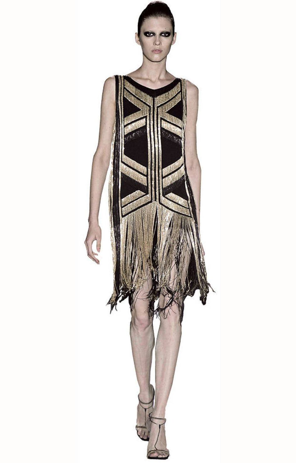 A beaded flapper-inspired dress graces Gucci's spring collection.