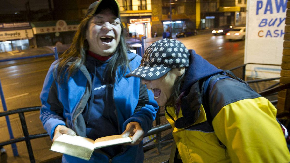 """Darlene and Rob who call themselves """"the crazy cousins"""" outside First United Church in Vancouver's downtown Eastside December 6, 2011."""