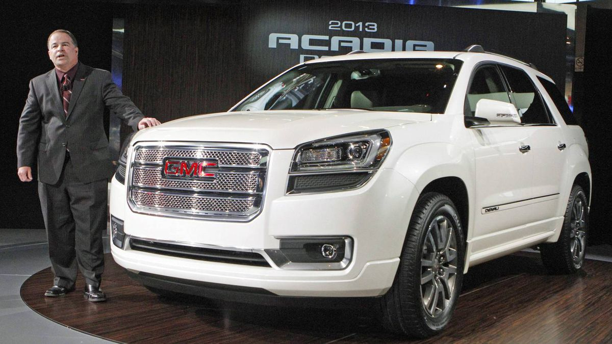 Tony DiSalle, U.S. Vice President of GMC Marketing, stands next to a 2013 GMC Acadia Denali during the first media preview day at the 2012 Chicago Auto Show in Chicago, Illinois February 8, 2012. REUTERS/Frank Polich