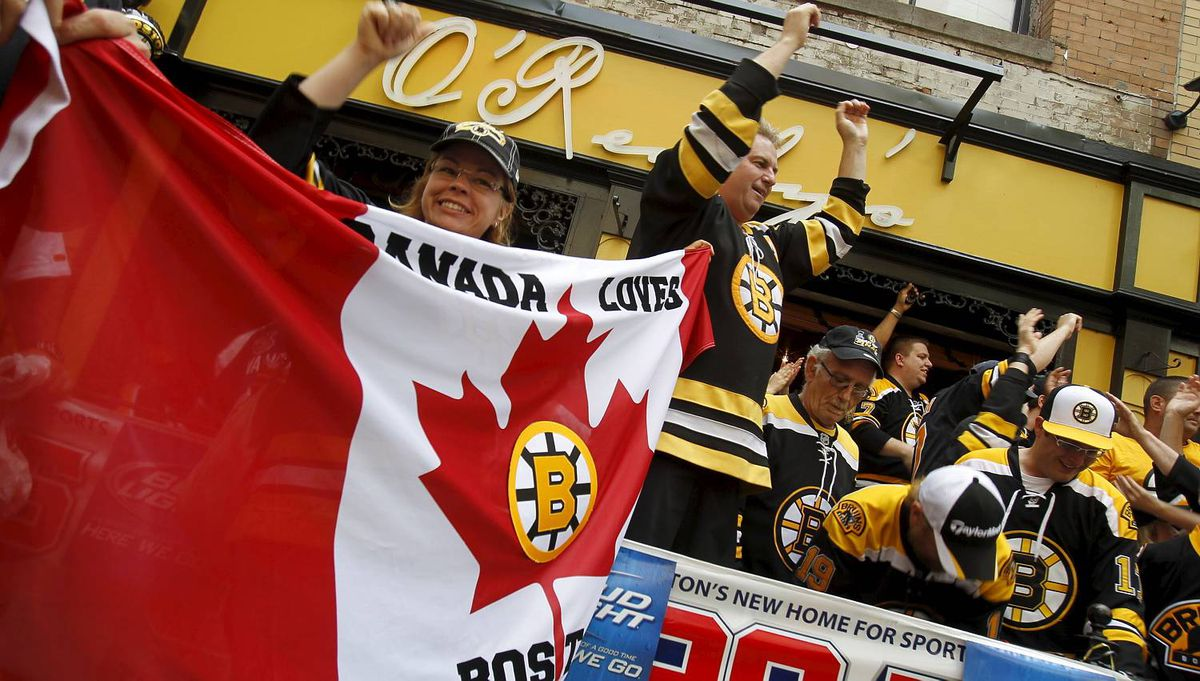 Canadian Bruins fans celebrating in the streets around the Boston Garden before the beginning of the NHL Stanley Cup Final Game 6 in Boston on June 13, 2011. (Photo by Peter Power/The Globe and Mail)