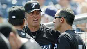 Toronto Blue Jays manager John Farrell, center, talks with his first base coach Torey Lovullo, right