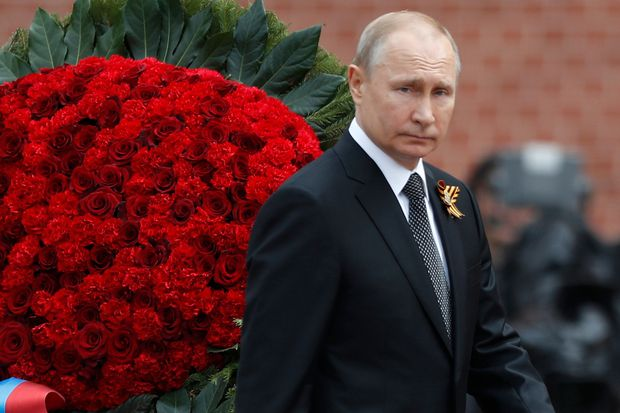Putin tells Victory Day parade that Russia will continue to strengthen its armed forces