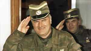 General Ratko Mladic salutes, followed by his senior aide General Milan Gvero Belgrade on March 26,1993.