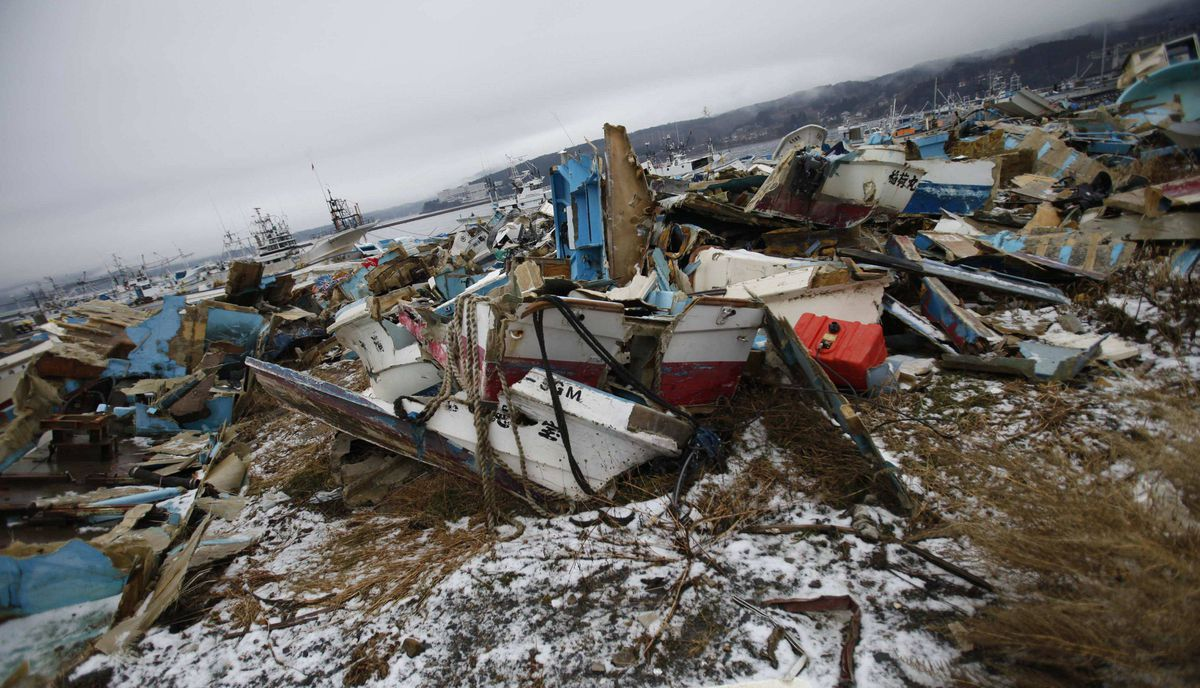 Demolished ships are pictured near the fishing port of Minamisanriku town, in Miyagi prefecture, northeastern Japan February 23, 2012. Only 5.8 percent of boats in the fishing town survived the March 11 tsunami according to the municipal government.
