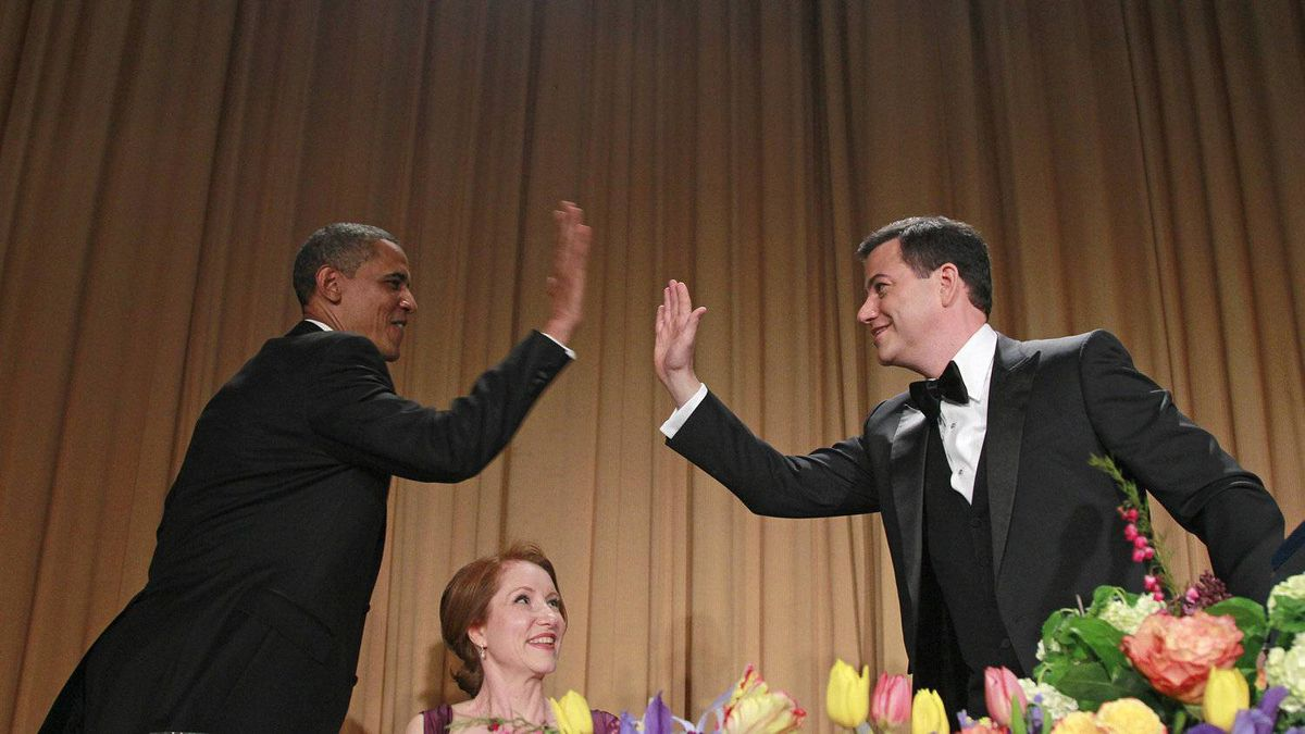 President Barack Obama high-fives late-night comic Jimmy Kimmel as Caren Bohan, a Reuters journalist and president of the White House Correspondents' Association watches during the White House Correspondents' Association Dinner, Saturday, April 28, 2012 in Washington.