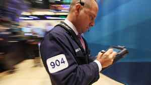 Traders work on the floor of the New York Stock Exchange in morning trading on August 9, 2011 in New York City.