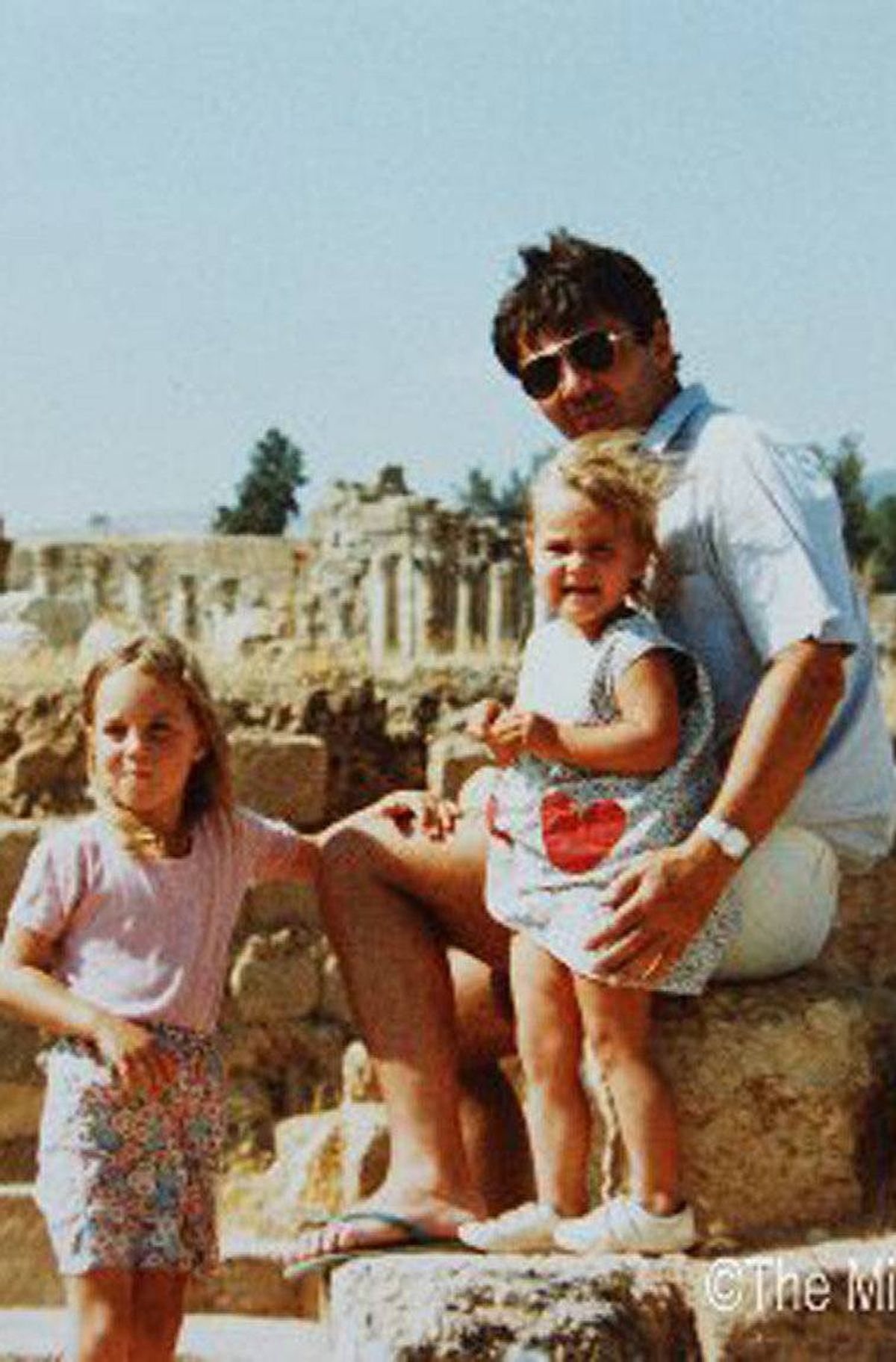 An undated photo of the Middleton family vacationing in Jerash, Jordan. Kate, aged four (L) with sister Pippa and her father Michael.
