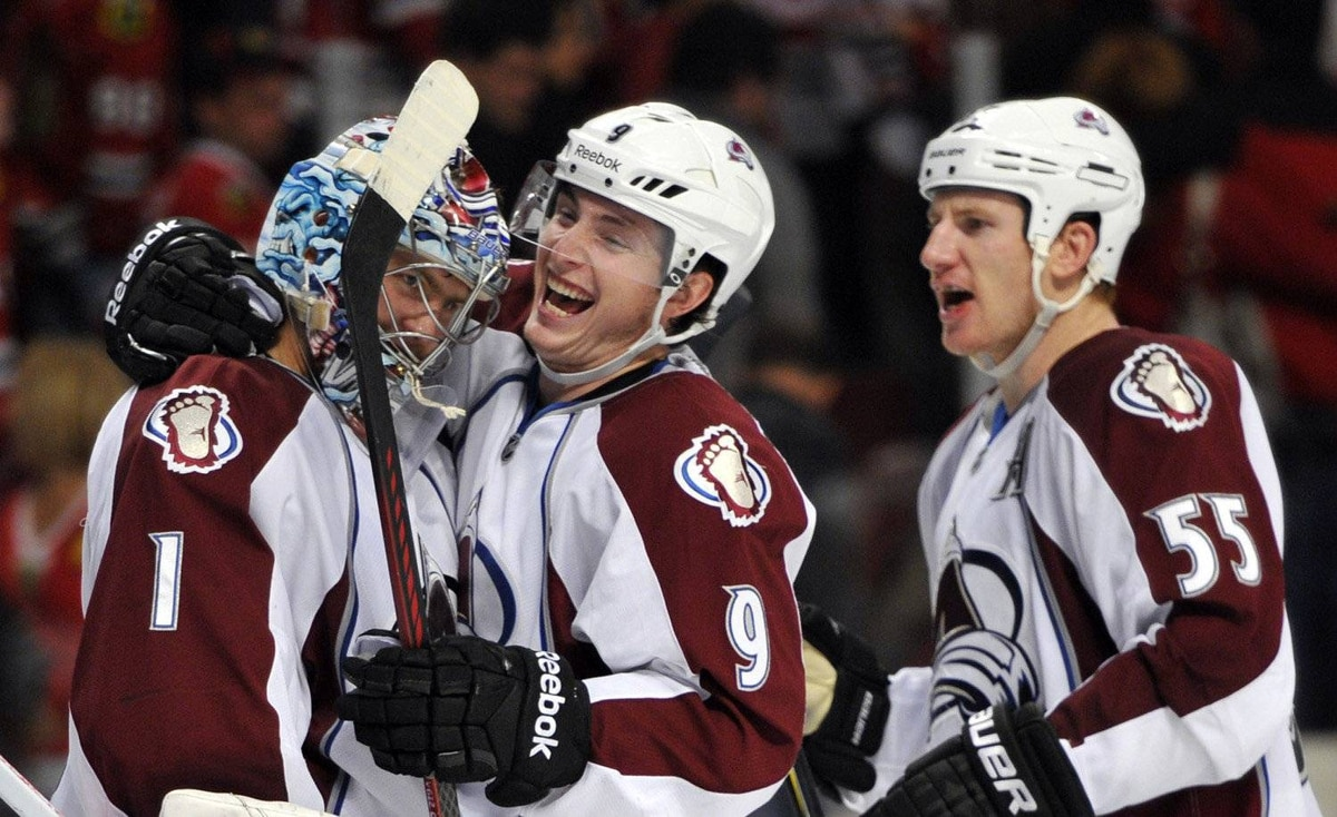 Colorado Avalanche goalie Semyon Varlamov (1) is congratulated by center Matt Duchene (9) and Colorado Avalanche left wing Cody McLeod (55) for an overtime victory against the Chicago Blackhawks at the United Center. The Colorado Avalanche beat the Chicago Blackhawks 5-4 in overtime.