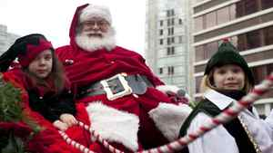 Canucks Place Children's Hospice patient Amadaya Cooke, 8, (L), and her friend Kenzie Oyhenart, 9 ride with Santa Claus during the 7th annual Rogers Santa Claus Parade Dec. 5, 2010.