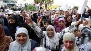 Supporters of the Islamist Ennahda movement chant slogans during campaign manager of the Ennahda party, Abdelhamid Jlazzi's speech outside the party's headquarters in Tunis October 24, 2011.